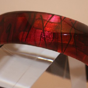 Acrylic three cornered bangle in Red