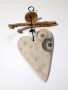 Ceramic and driftwood hearts