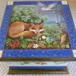 hand painted box of a fox in his den