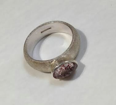 Silver ring with faceted quartz