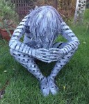 Forged Iron Seated Figure