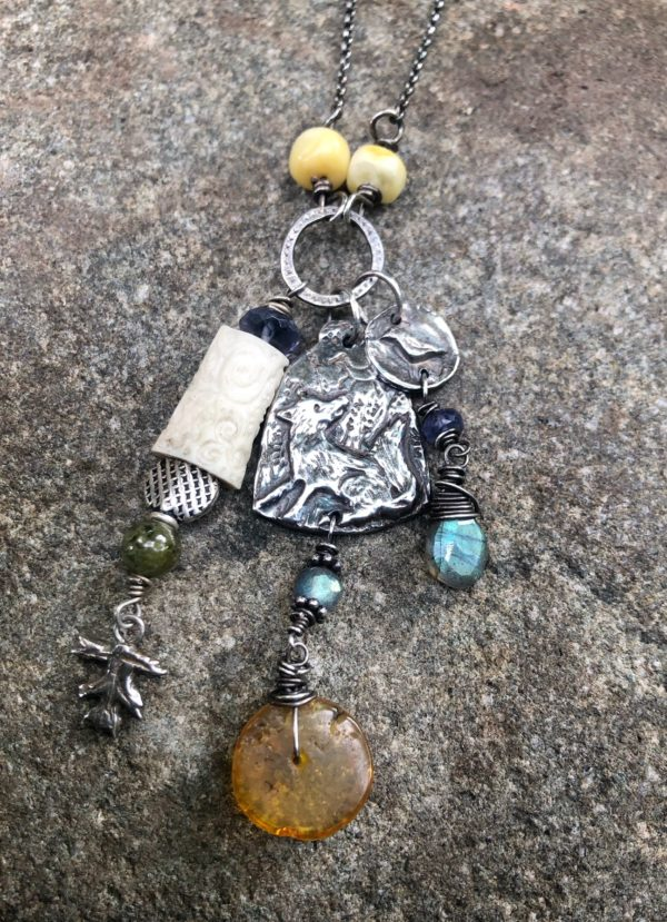 Silver fox totem pendant with amber