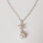 Silver and Pearl Tiny Flower Pendant