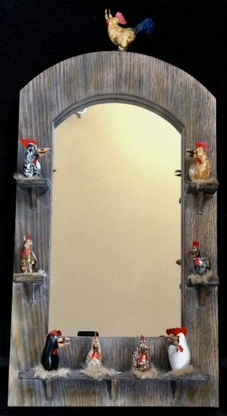Hand carved wooden chicken mirror