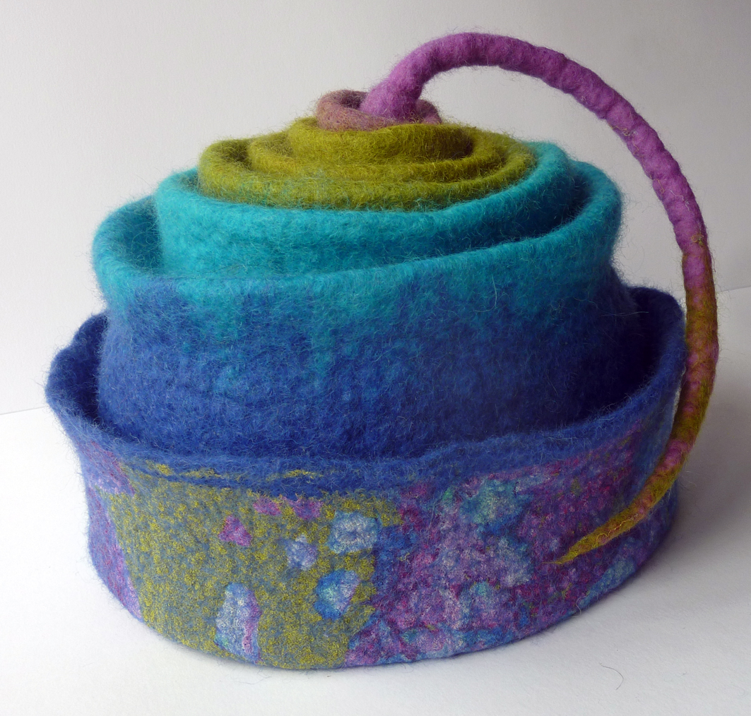 Hand Felted Concertina hat in Rainbow