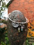 Silver Bangle with Uffington, Bronze Heart, Green Garnet, Turquoise, Amethyst, Garnet.