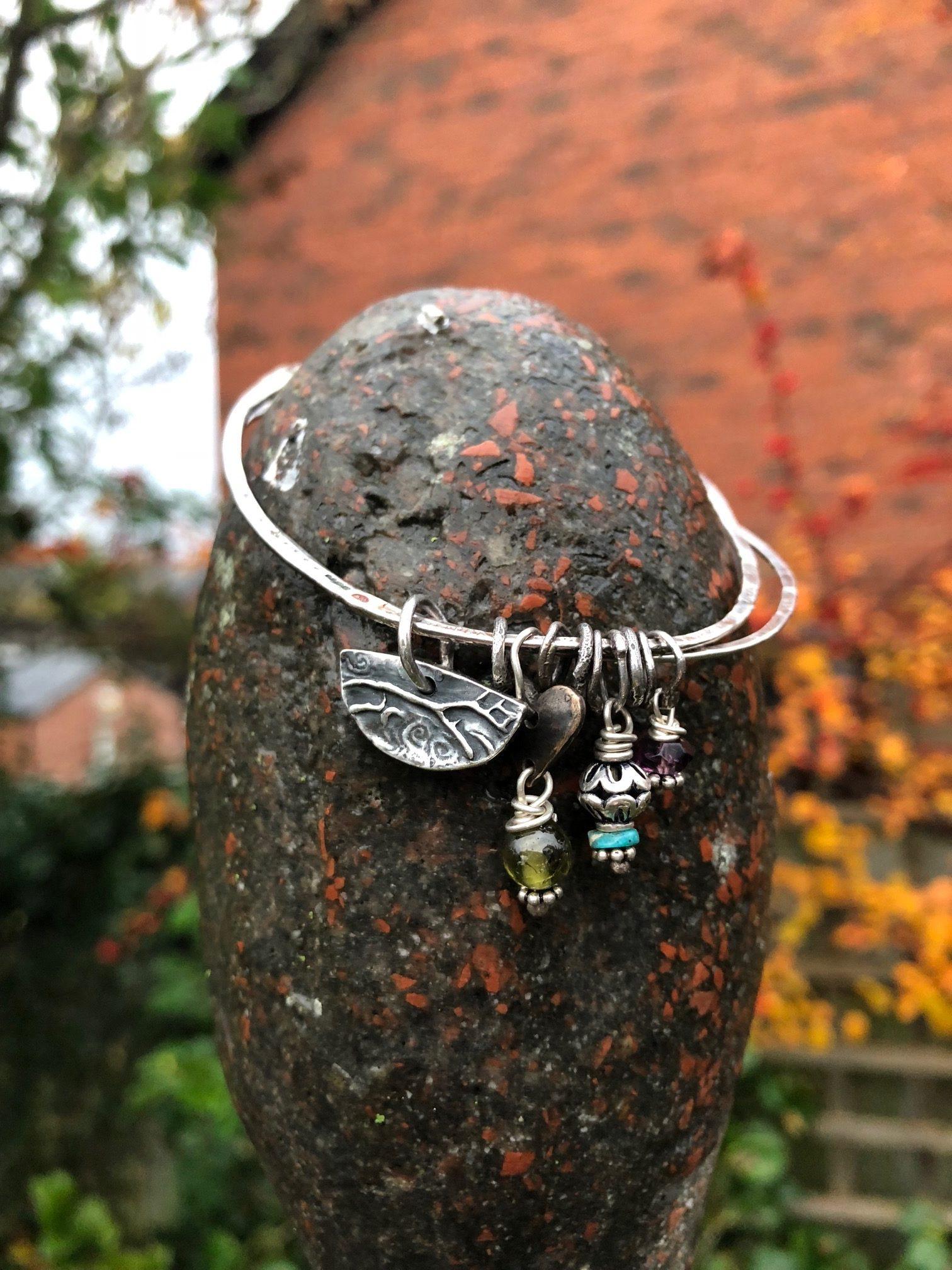 Silver Bangle with Uffington, Bronze Heart, Green Garnet, Turquoise, Amethyst, Garnet.