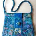 Hand felted shoulder bag in Finn wool with design in vintage silk fabrics.