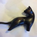 Hand carved wood sculpture cat with turned head