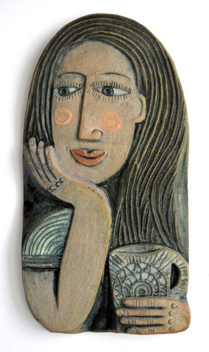 Ceramic Relief Taking a Break