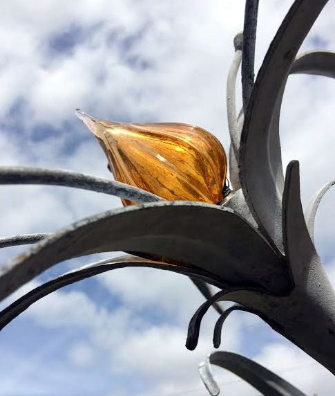 Forged steel and blown glass
