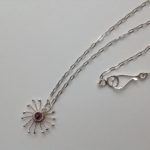 Silver Sunstar and Garnet Pendant