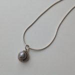 Bound Circle Pendant and Freshwater Pearl