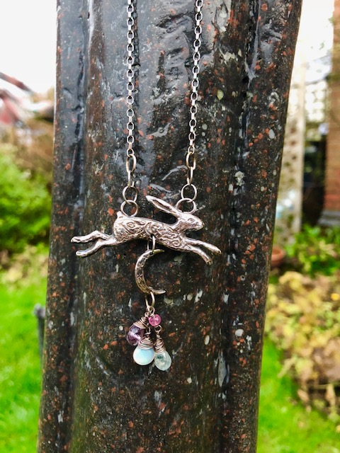 Silver Hare pendant with Opal, Amethyst, Ruby and Aquamarine