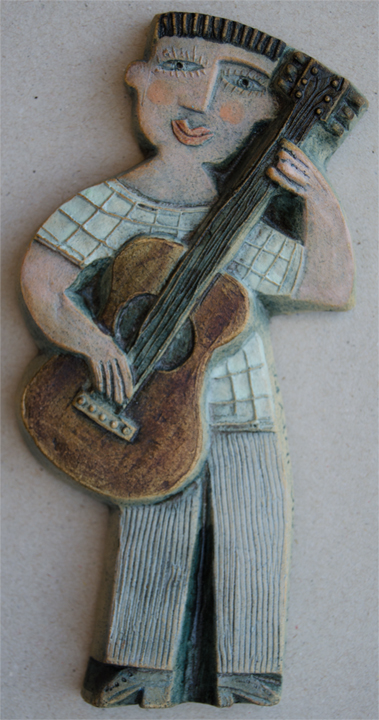 Ceramic Relief Guitar Player