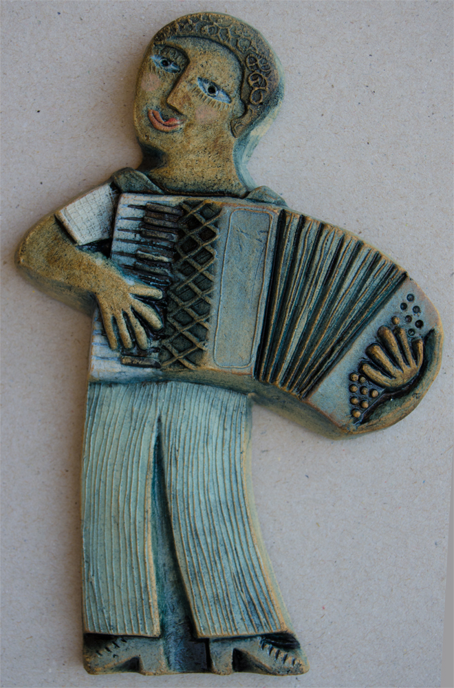 Ceramic Relief Accordion Player