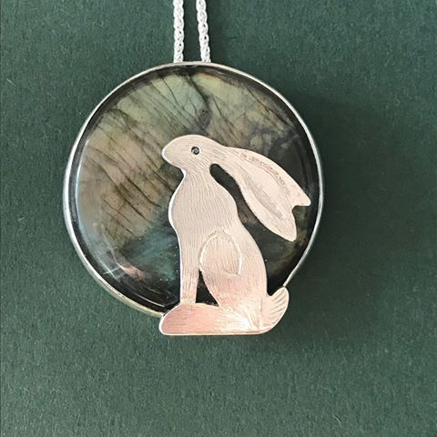 Silver Pendant 'Sunset Hare' on Labradorite