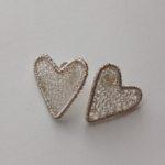 Framed heart studs in silver