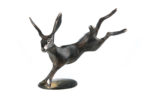 Bronze leaping hare with tan patination and polished tips.