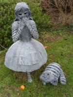 Forged and galvanised Alice and her Cheshire Cat