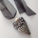 Silver Heart Necklace with relief and ivory pearl
