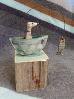 Ceramic and Driftwood  Dog in a boat