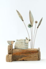 Ceramic and Driftwood Two in the High Grass