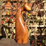 Hand carved wood sculpture  Cat Looking Back