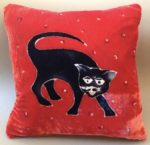 Black Cat on Red Cushion