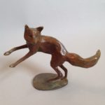 Bronze Fox Leaping