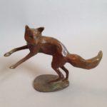 Bronze Fox Leaping