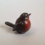 Bronze Tiny Perching Robin