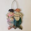 'Mermaid and Merman Hang Up'