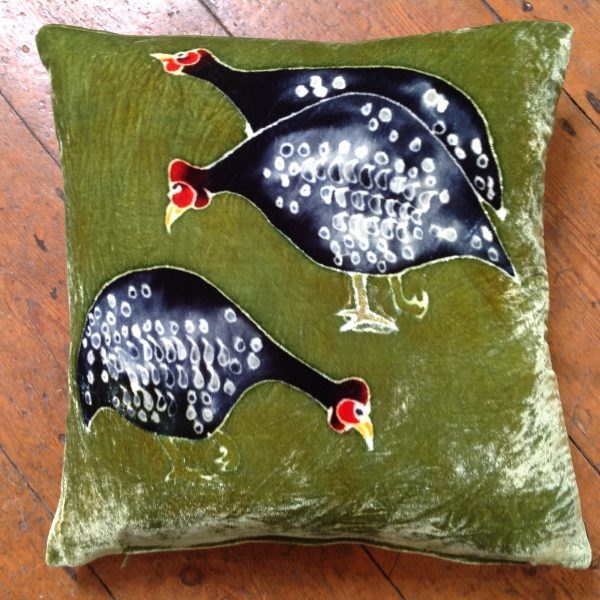 Guinea Fowls on Green Cushion