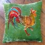 Cockerel on Green Cushion