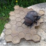 Bronze Resin Bee on Honeycomb